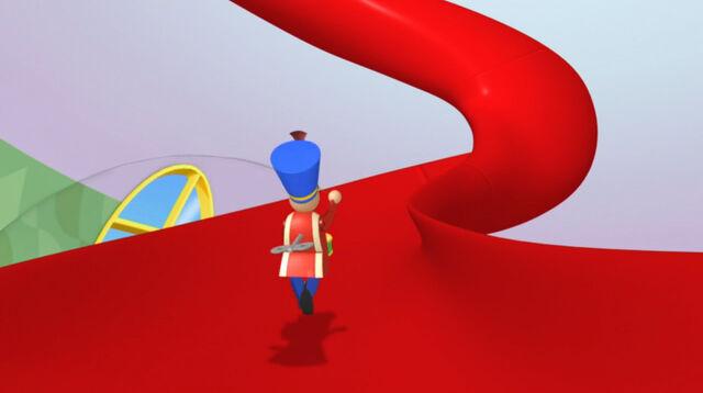 File:Drummer toy goes up the slide.jpg
