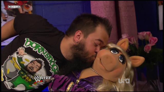 File:WWE-Raw-Kiss-Piggy-Hornswoggle-(2011-10-31).png