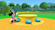 Minnie goes after the little toy marcher