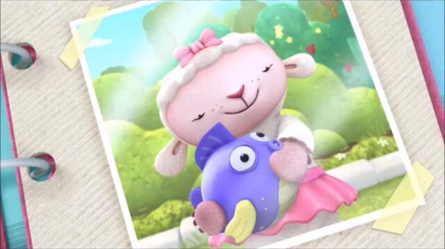 File:Picture of lambie cuddling squeakers.jpg