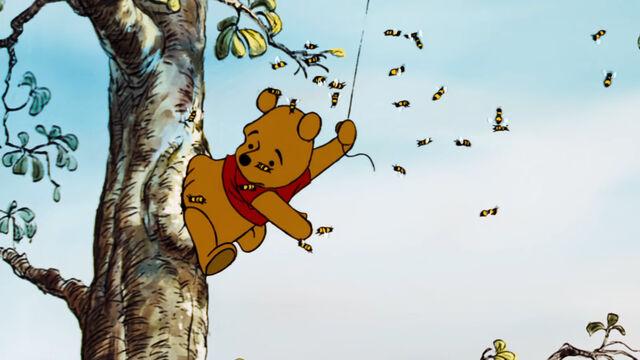 File:Winnie the Pooh got his bottom stuck in the honey tree.jpg