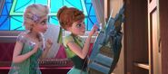 Elsa-and-anna-looking-at-the-clock-in-frozen-fever