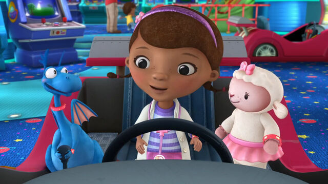 File:Doc, stuffy and lambie at a car game.jpg