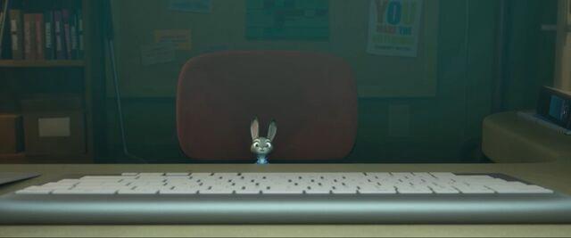 File:Judy at an elephant's desk.jpg