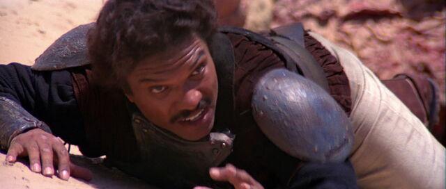 File:Lando Calrissian at the mercy of the Sarlacc.jpg
