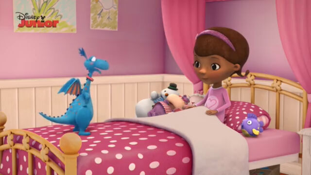 File:Doc and her toys in bed.jpg