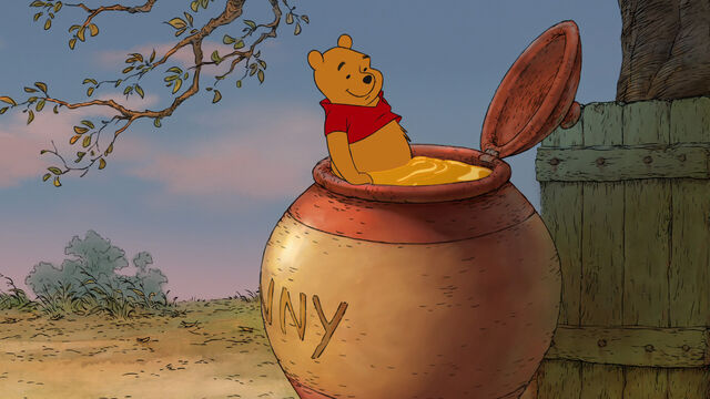 File:Winnie the Pooh is getting in the giant honey pot.jpg