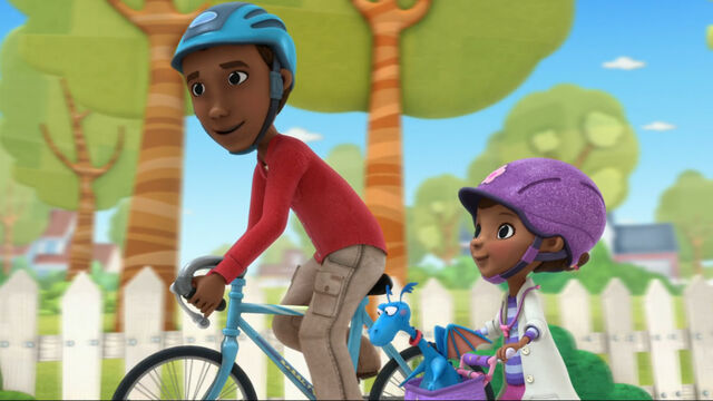 File:Doc and her dad riding their bikes.jpg