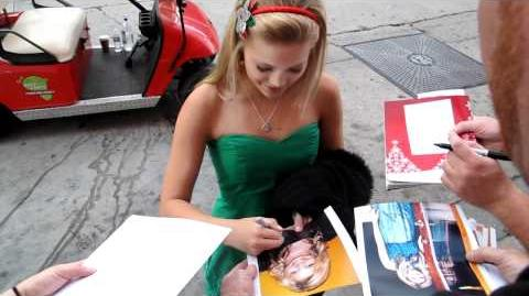 Olivia Holt signing autographs at Hollywood Christmas Parade 2011.