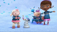 Lambie gives one of the snowpeeps a blood preasure