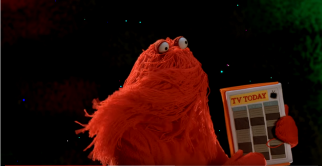File:Red Guy with TV Schedule.PNG