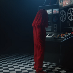 Red Guy looking at the machine
