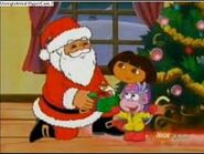 Santa opening his present