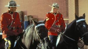 Constable Benton Fraser Sergeant Buck Frobisher on horses