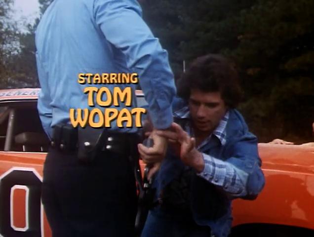 File:Tom Wopat - Title Card.png