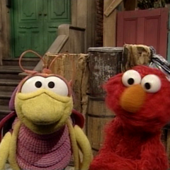 Elmo and Bill informing the viewer they will head to Grouchland for adventure in the introduction menu featurette.