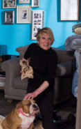 Shirley Carter holding a puppy (2014)