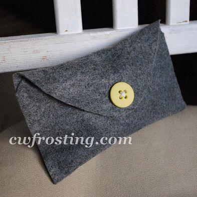 http://www.cwfrosting.com/2011/06/no-sew-buttoned-felt-envelope