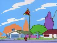 Ed on top of a street light