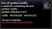 A box of spotted moths