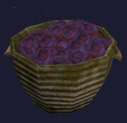 Basket of rotting pomegranates
