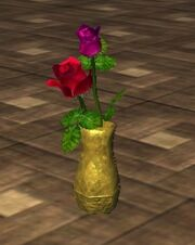 Red and Pink Roses in an Oval Vase (Visible)