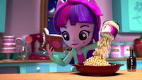 Twilight pours kernels into a bowl EGM2