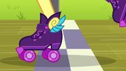 Pinkie skates over the checkered line EG3