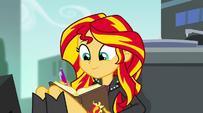 Sunset writing a friendship report to Princess Twilight EG2