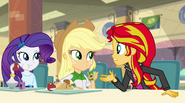 Sunset explains to Applejack and Rarity EG2