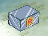 Archivo:EP528 Caja del Team Rocket.png