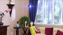 Jessie reaching for vase
