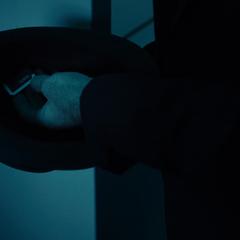 Joe Miller hides Julie Mao's data cube inside his chapeau