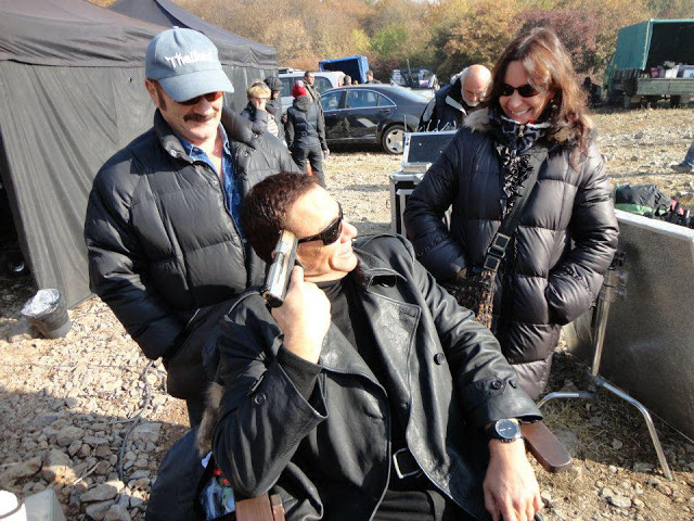 File:JCVD jokes around on-set with assistants.jpg