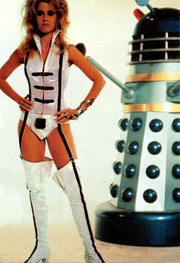 DWM 289 - Bafflement and Devotion - Jane Fonda Iris Wildthyme with Dr Who and the Daleks Dalek