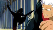 Sol sneaks an attack from behind Elfman