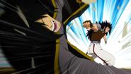 Gajeel punches Rogue away