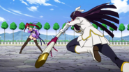 Kagura charges towards Erza