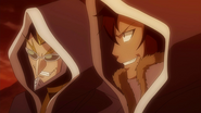 Eric and Sawyer listen to Jellal's words