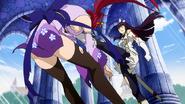 Kagura kicks Erza