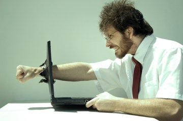 File:Angry-man on computer.jpg