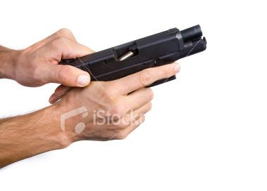File:Ist2 4378782-hands-cocking-gun.jpg