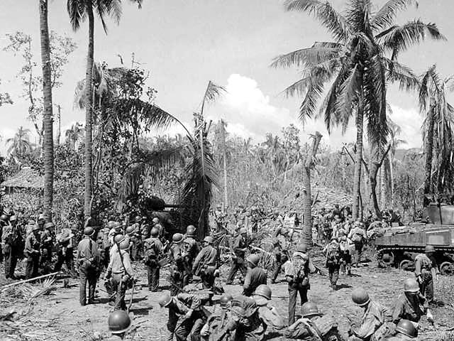 File:Men and equipment on Leyte beachhead.jpg