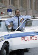 Reginald as Officer Carl