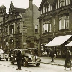 An old photo of the Red Lion pub in 1959, which still stands today, along with the tram lines (though now improved) and other buildings pictured. However, it is no longer a pub, becoming a <i>Lloyd's TSB</i> in 1964, which it still is today.