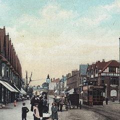 The Ambrose Hill High Street in 1921, before the inception of the paint craze. All of the buildings still remain, and note the arch in the far background, which was renovated in 2034.