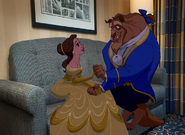 Belle and Beast sitting happily at Disneyland Hotel Room