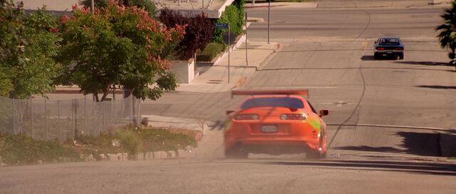 File:Supra chasing Charger.jpg