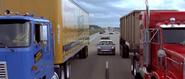 Heading in between two trucks