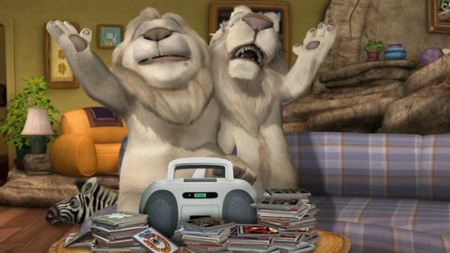 File:Father of the Pride Larry and Sarmoti Singing.png